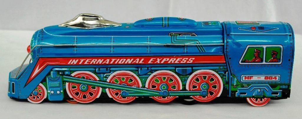2 Tin litho Toys - International Express Locomotive And - 4