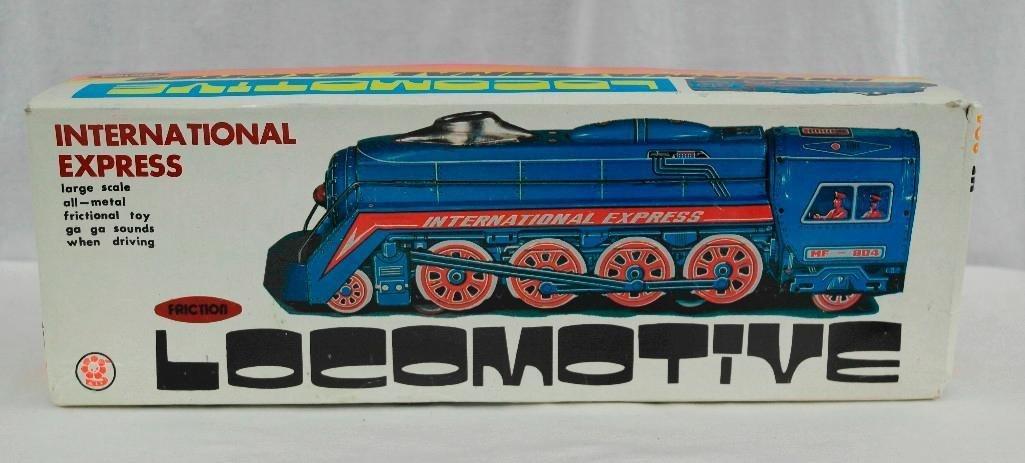 2 Tin litho Toys - International Express Locomotive And - 6