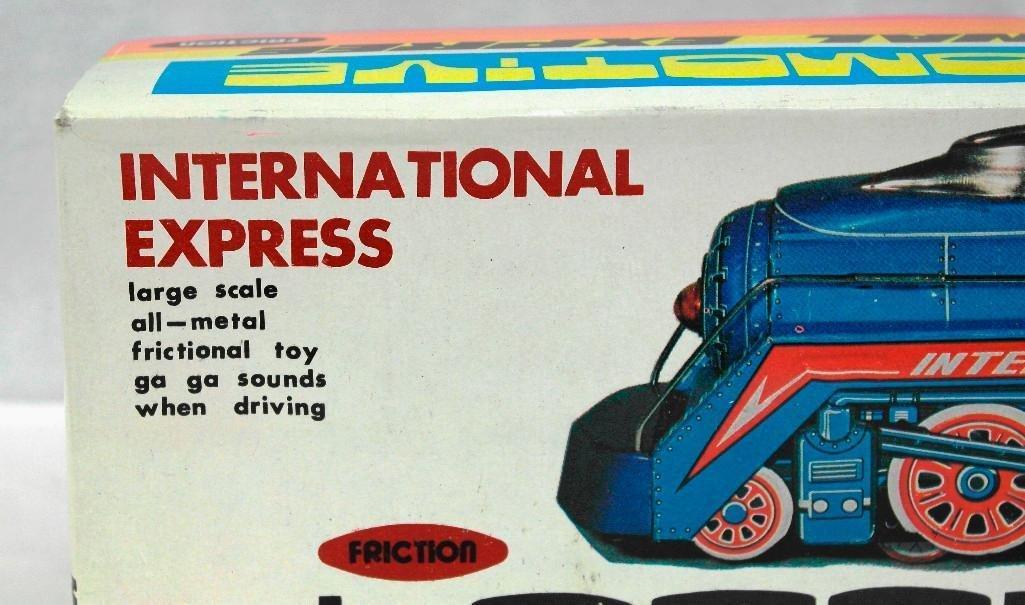 2 Tin litho Toys - International Express Locomotive And - 7