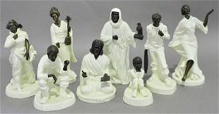 Collection of Eight Minton Figurines