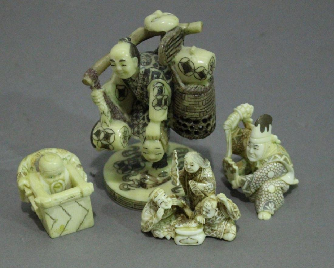 Group of Four Japanese Carved Figures