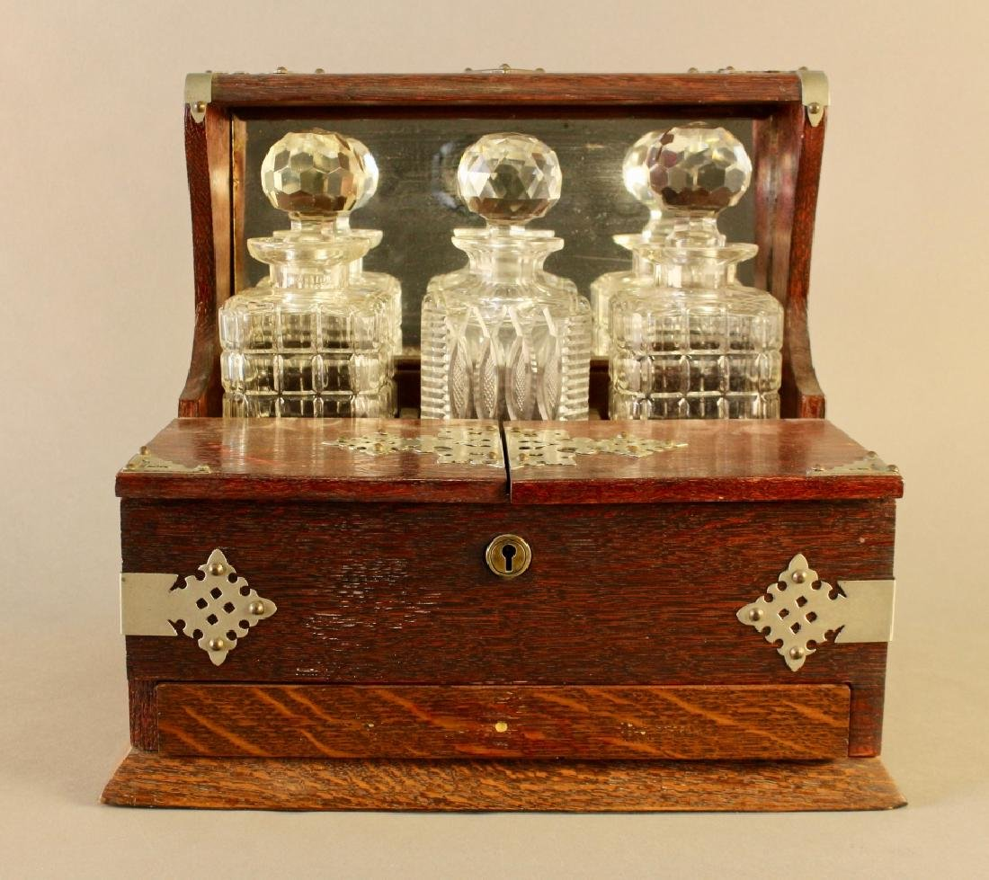 Three Bottle Tantalus in Oak Case
