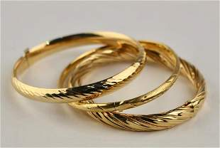 Three Gold Bangle Bracelets