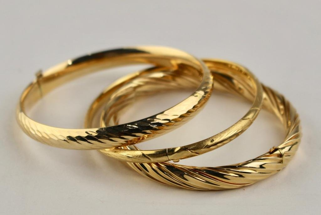 Three Gold Bangle Bracelets