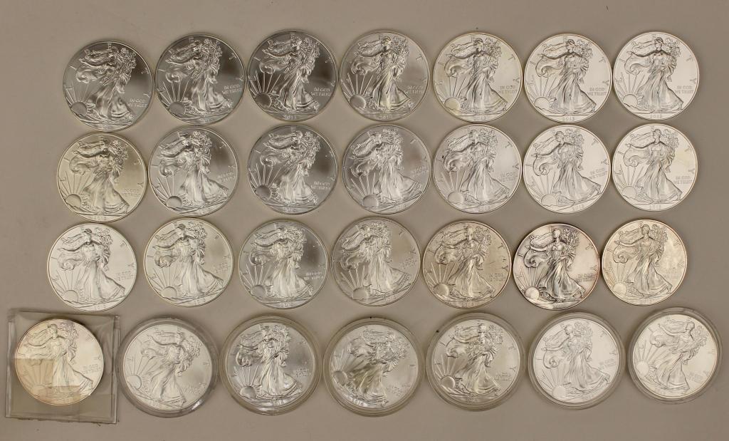 Twenty Eight Silver Dollars