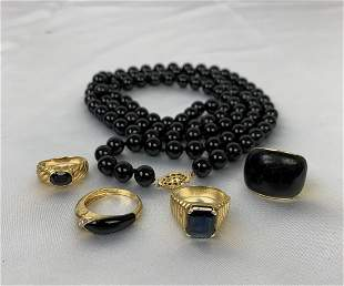 Lot of 14k yellow Gold & Onyx 1 necklace and 4 rings.