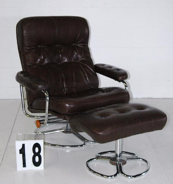 18: SIGNED LEATHER LOUNGE CHAIR