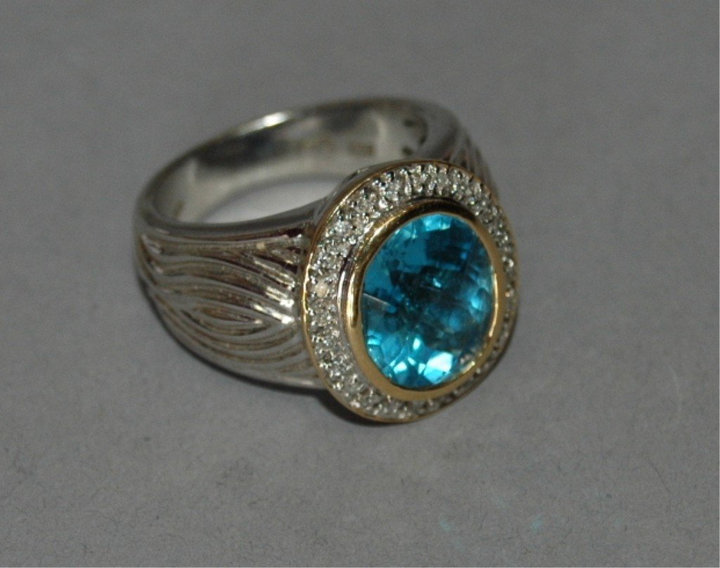 20: 18K White Gold Ring with Blue Topaz