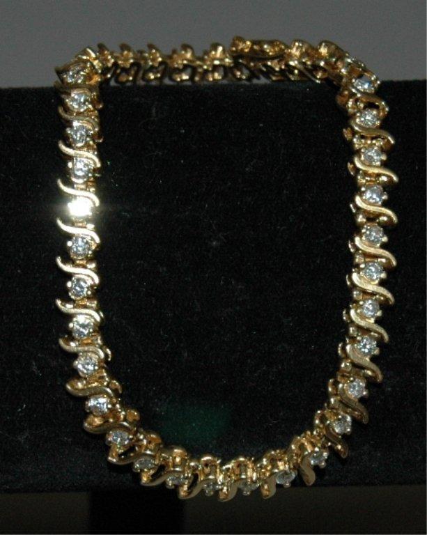 23: Diamond and 14K Tennis Bracelet