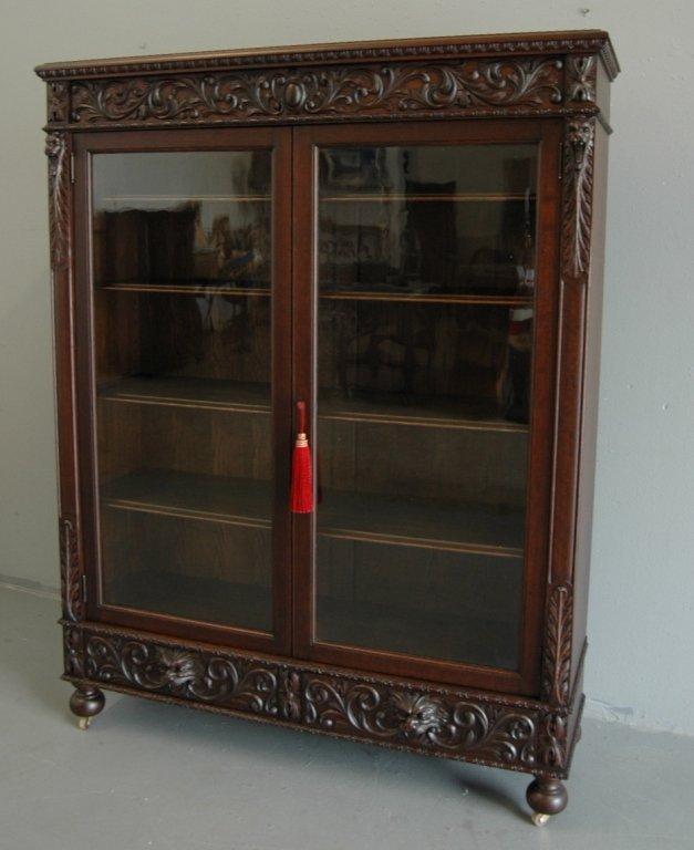 130: Carved Double Door Bookcase