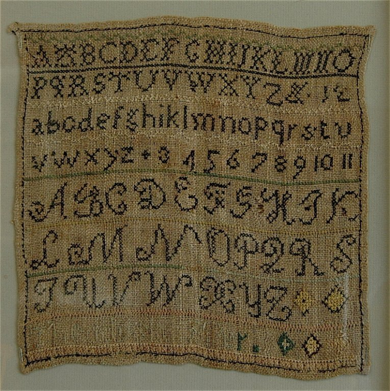 21: Early American Needlework Sampler