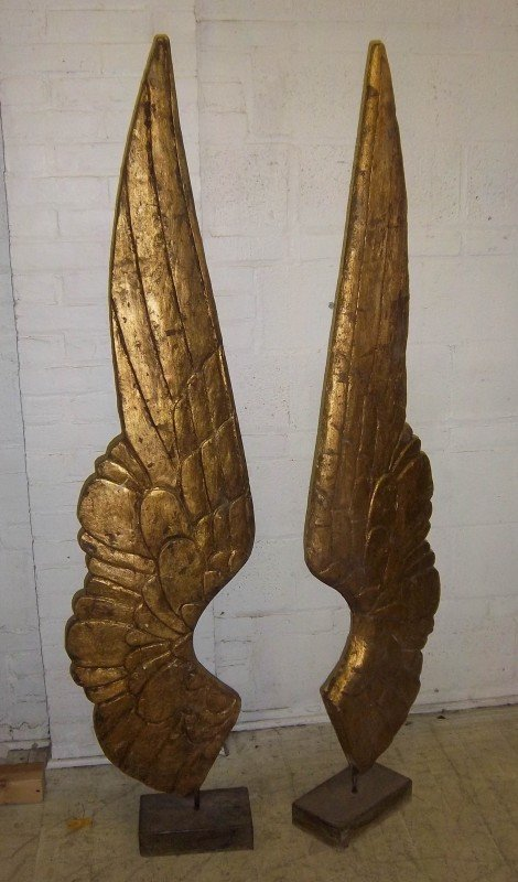7: Pair of large carved giltwood wings on stands