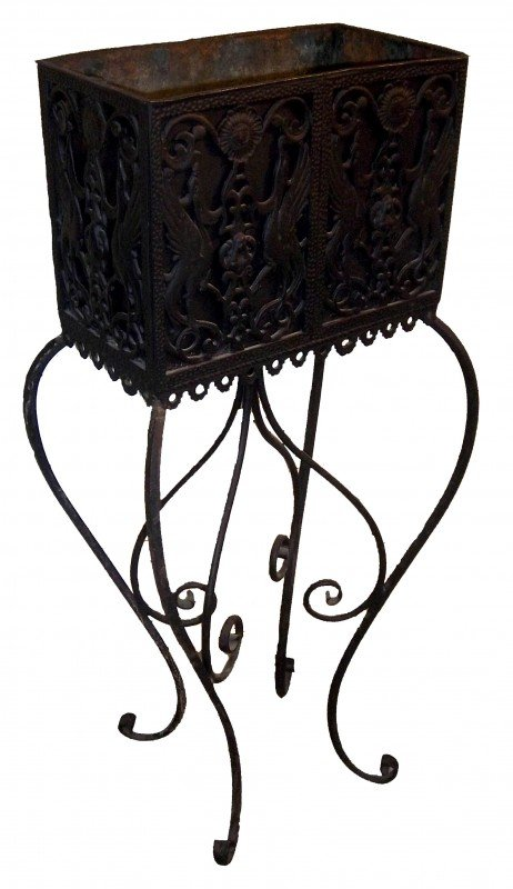 17: Rare bronze and iron planter with winged griffins