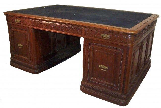128: Ca. 1890 carved walnut Victorian partners desk