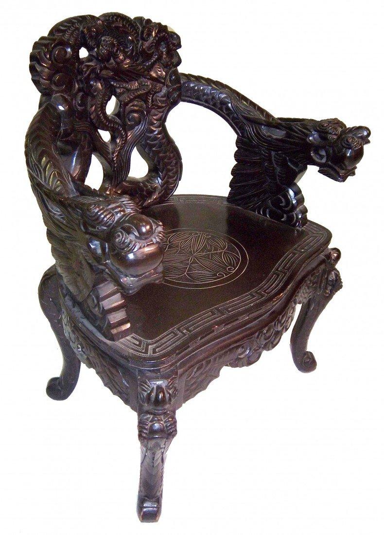 14: 19th C. Chinese teak armchair