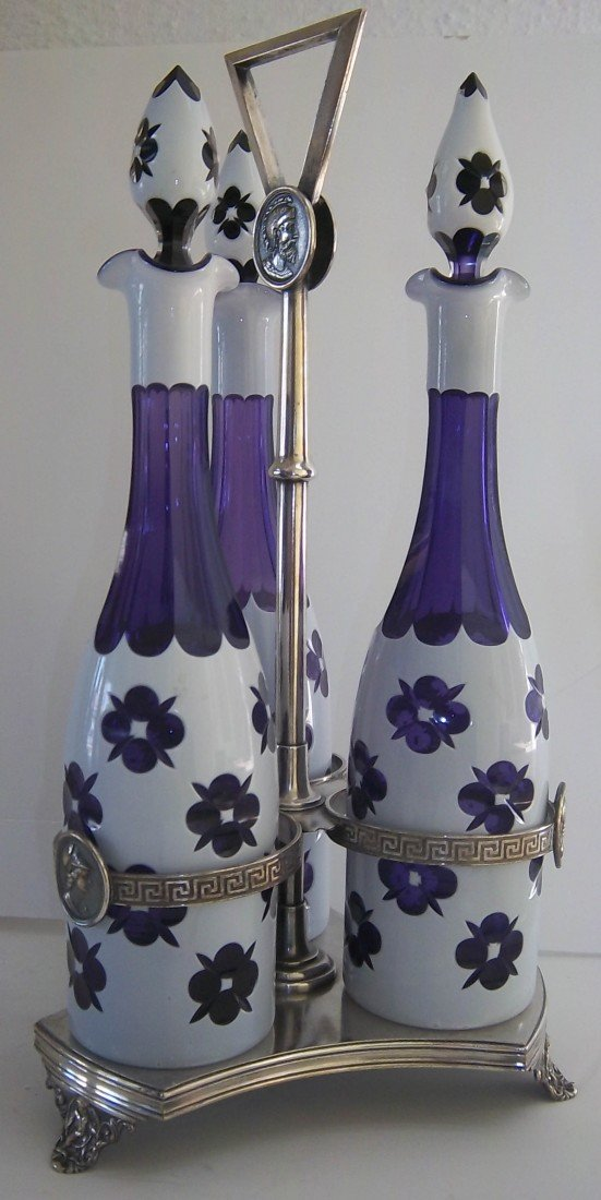 59: Ca1900 cased glass cruet set w/ Pairpoint holder