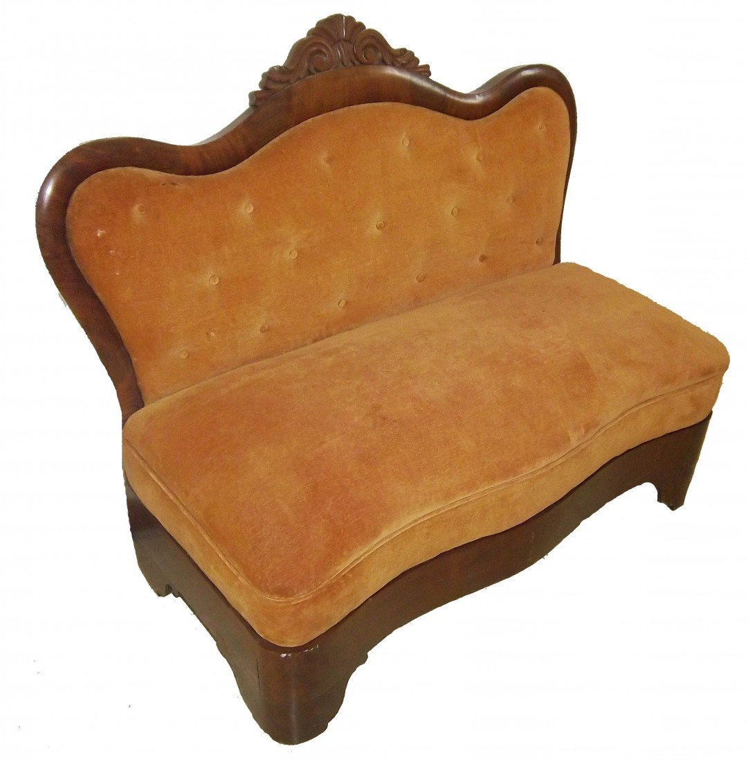 4: Period Empire settee with detailed crest