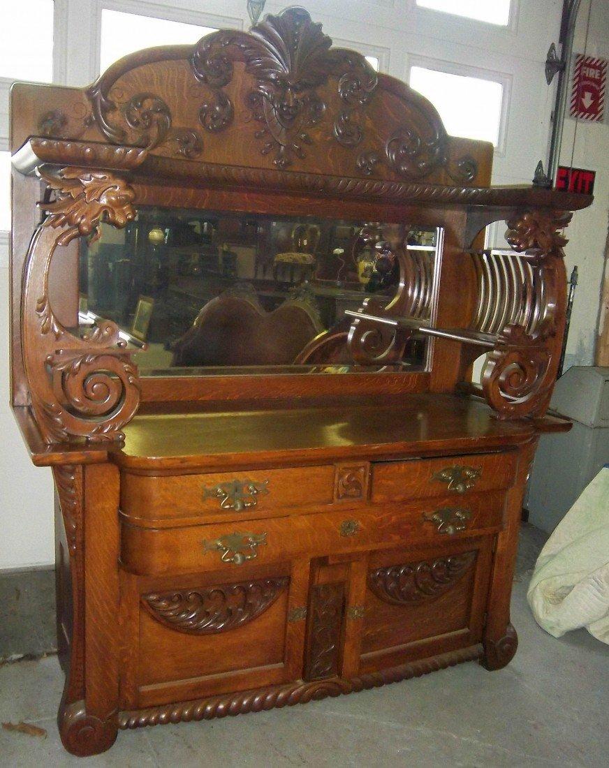 294: RJ Horner oak winged griffin sideboard