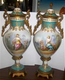 323: Pr. of 19th C. handpainted Sevres urns
