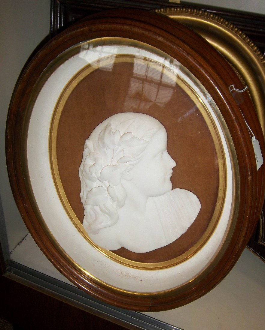 45: 19th C. marble silhouette in walnut frame