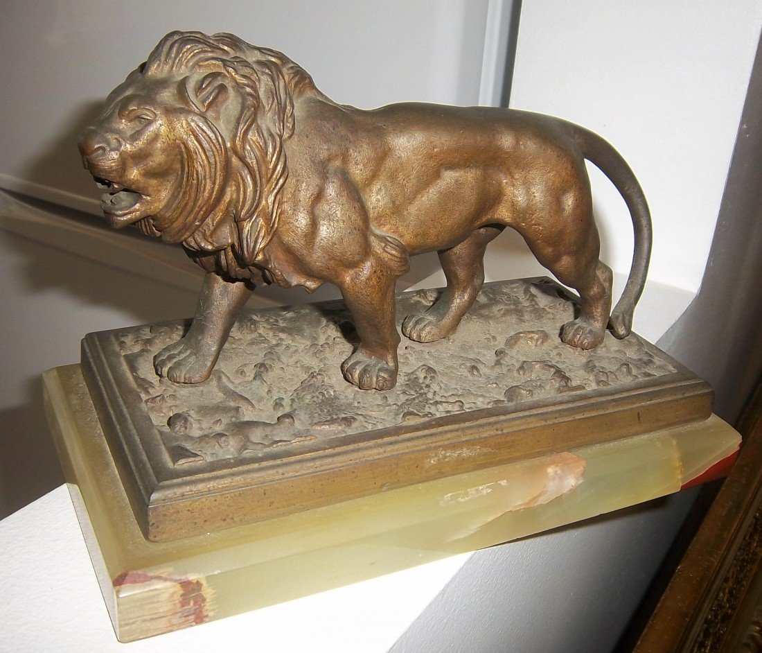 49: 19th C. bronze lion on onyx base