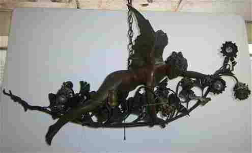 246: C1910 brass and wrought iron chandelier