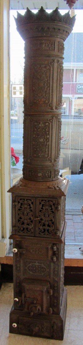 14: Ca 1900 American cast iron chimney stove