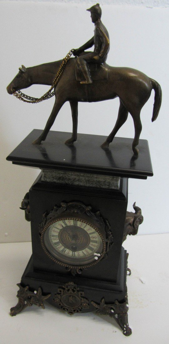 112: 20th C. Marble mantle clock with bronze jockey