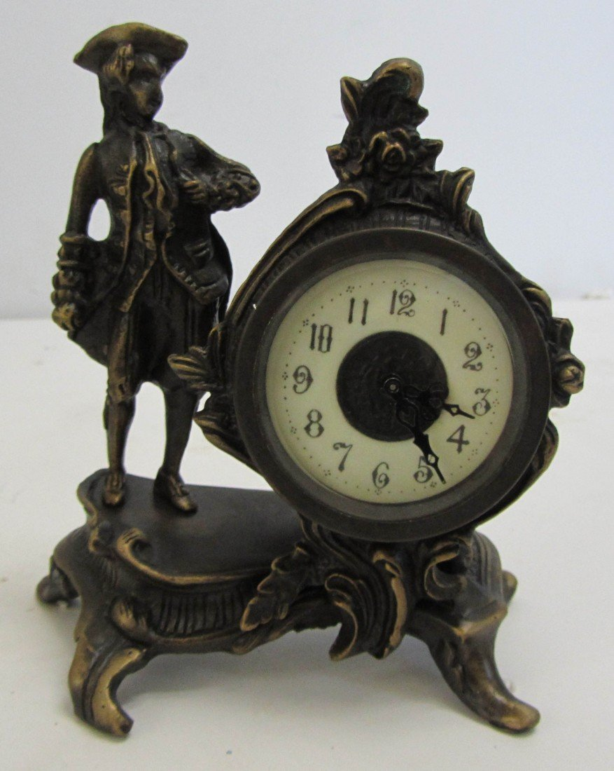 121: 20th C. Bronze clock with soldier