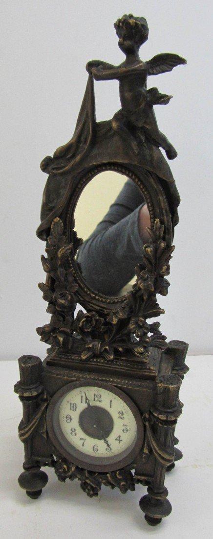 136: 20th C. bronze clock with mirror