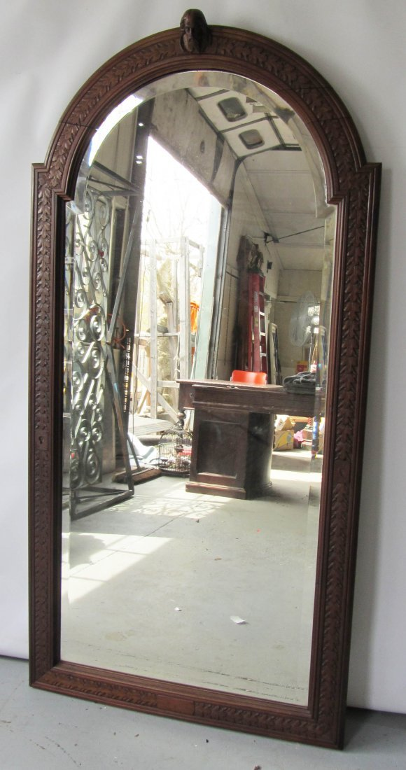 54: Large detail carved gothic mirror