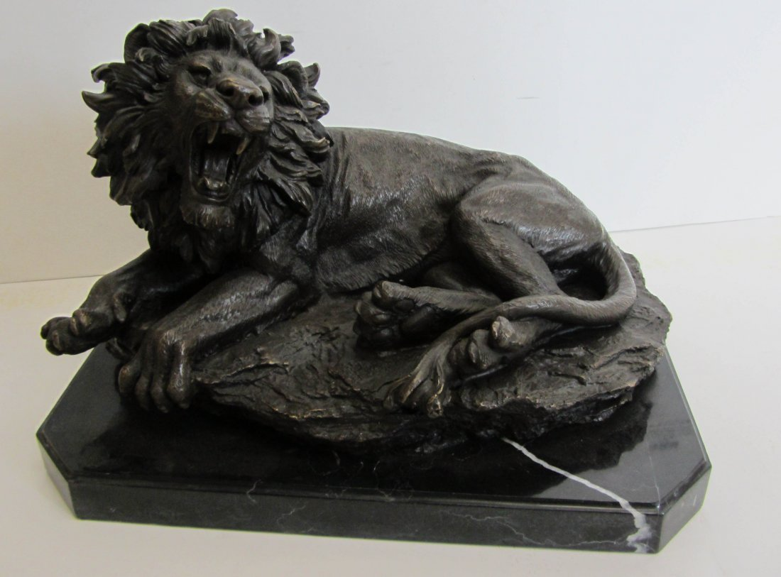 83: 20th C. bronze lion on marble base