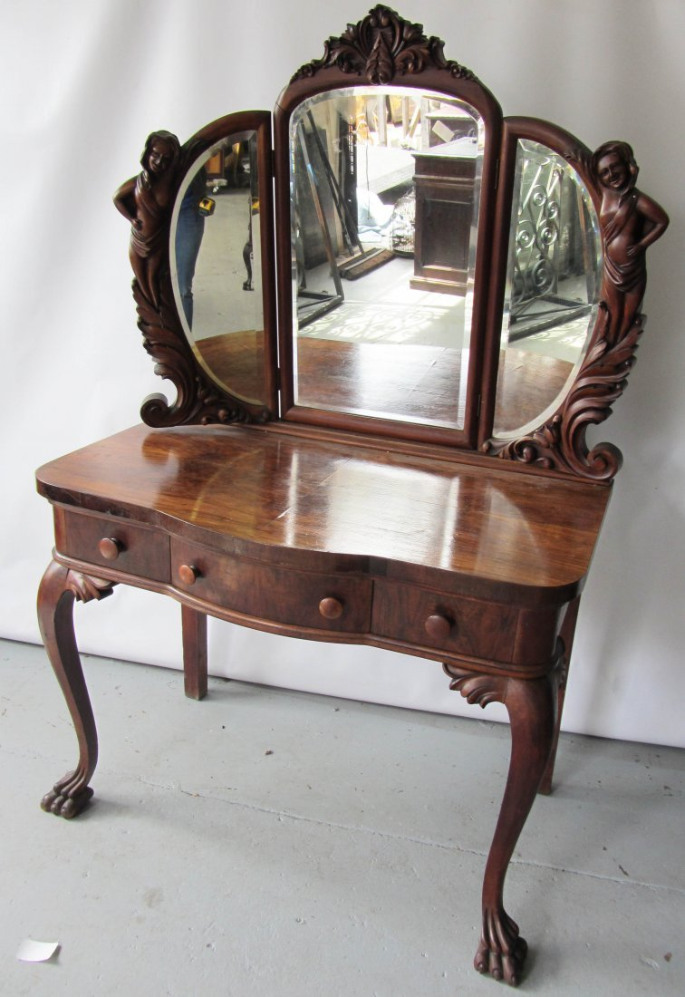 100: 19th C. Mahogany vanity with ladies by Karpen