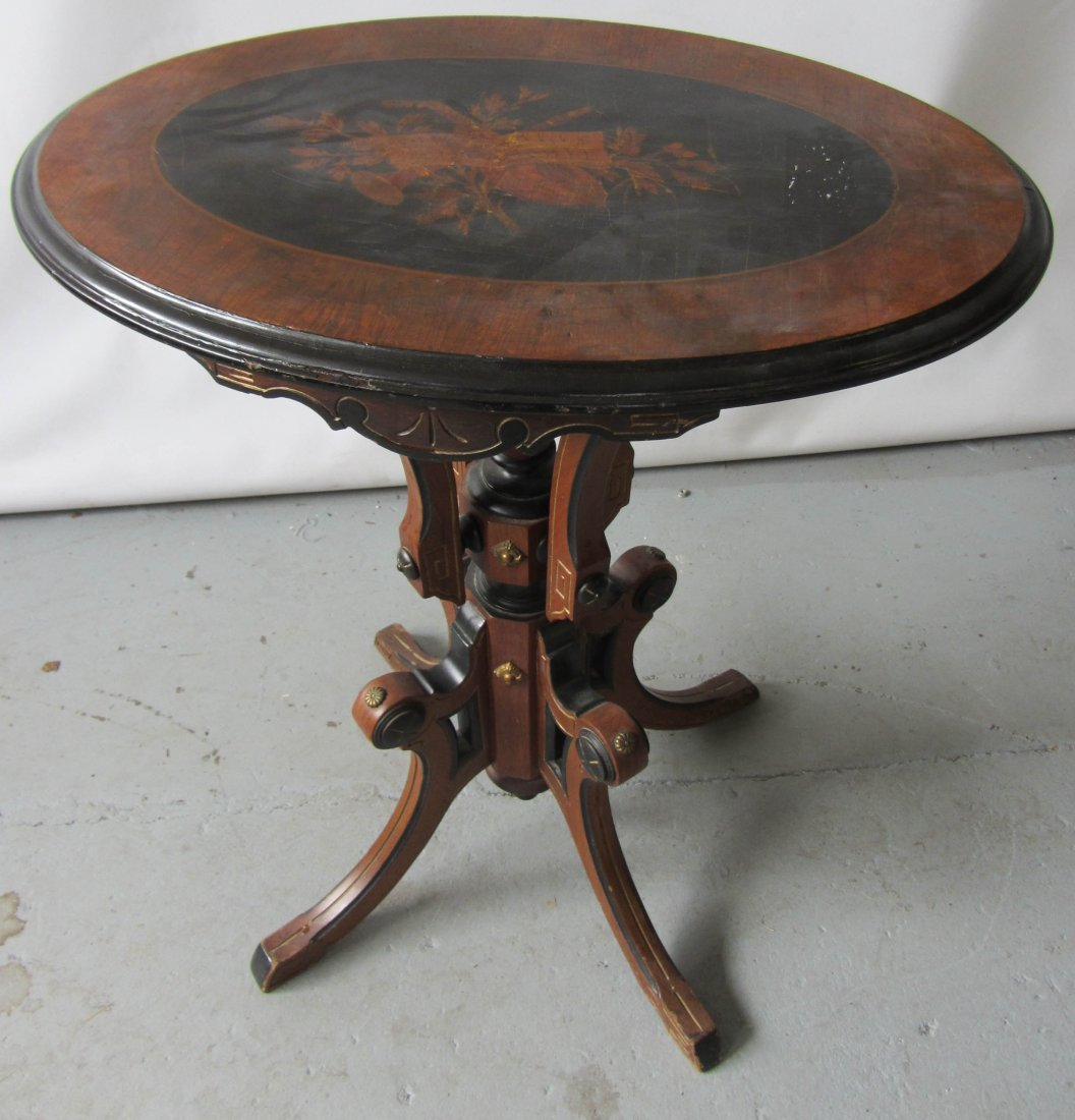 76: 19th C. Am. Victorian oval table with inlaid top