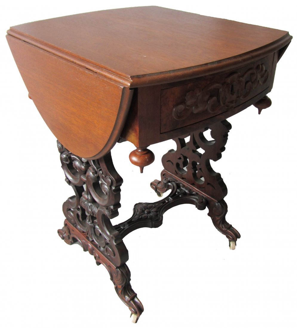 77: 19th C. American Victorian drop side sewing stand
