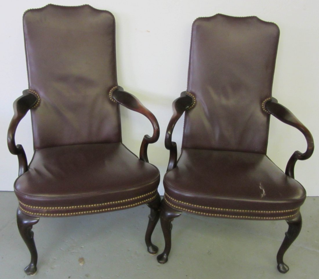 82: Pr. Mahogany and leather armchairs