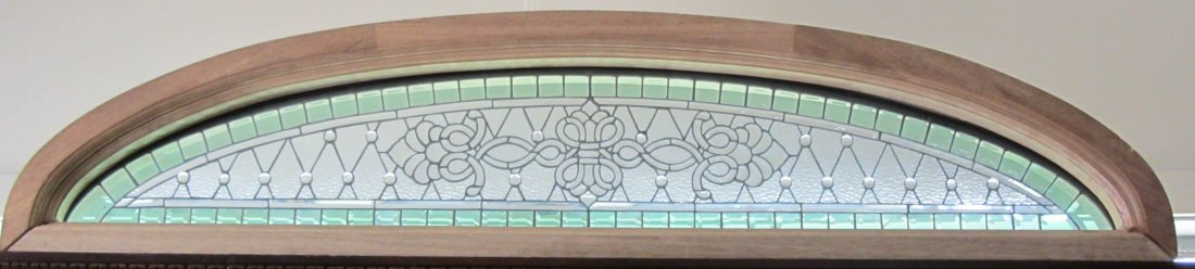 84: Large bevel and stained glass transom window