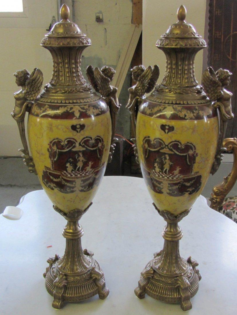 86: Pr. Large figural bronze and porcelain urns