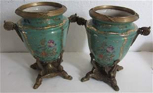 Pr 20th C. porcelain urns with flower decorations