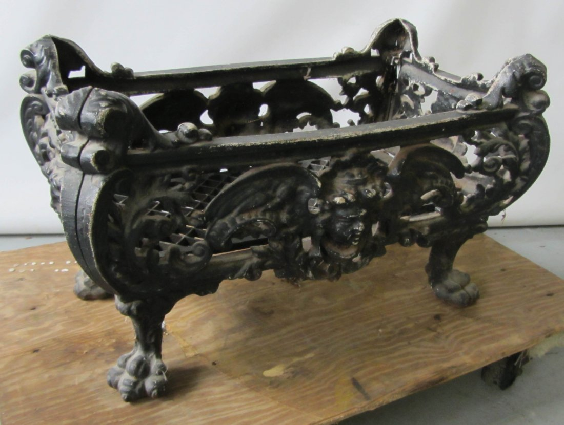 19th c cast iron fireplace log holder