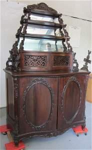102: Rosewood American Rococo etagere by Meeks