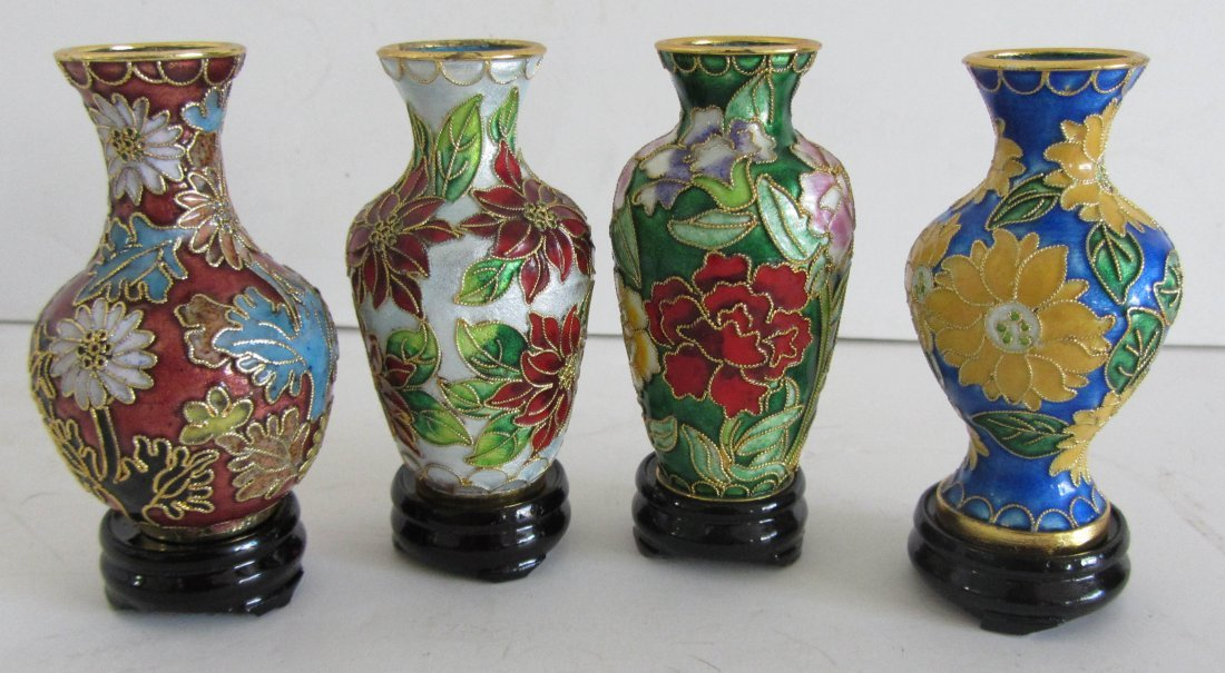 6: Set of 4 Small enameled urns on stands