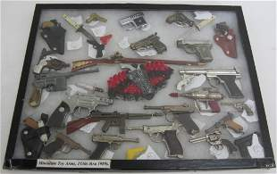 1930s - 1980s Miniature toy arms
