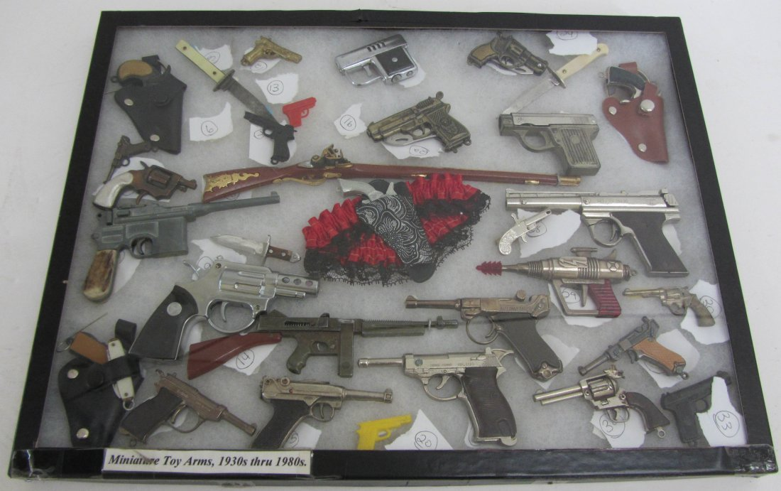 17: 1930s - 1980s Miniature toy arms