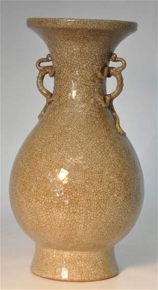 Brown glazed porcelain vase w/ two dragon holders
