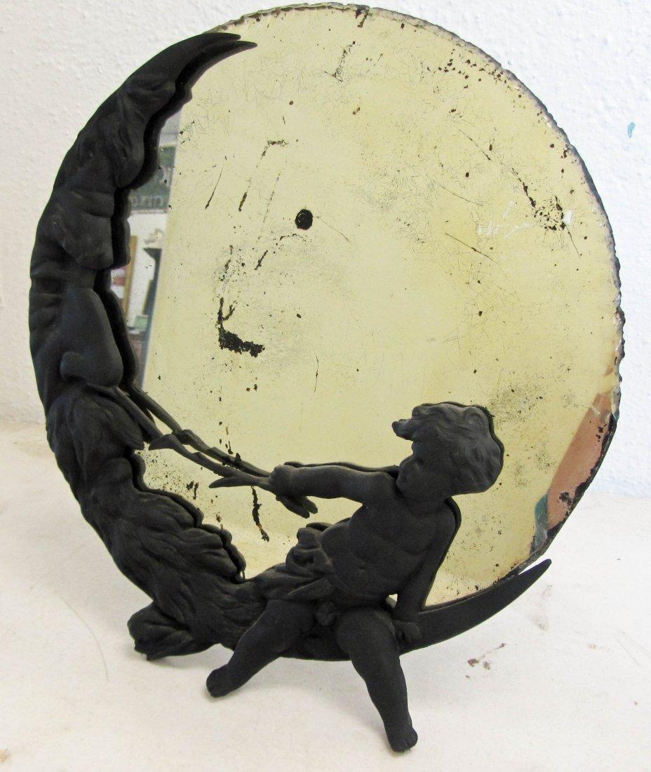 21: Figural mirror with cherub on moon frame 13 x 12