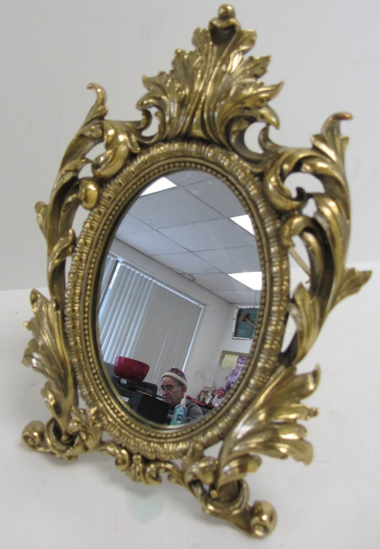21: Small French style mirror