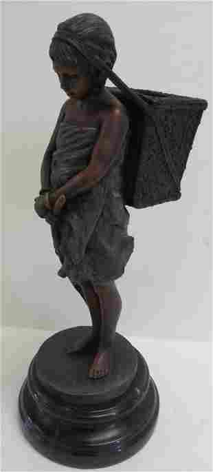 Bronze statue of child with basket on marble base