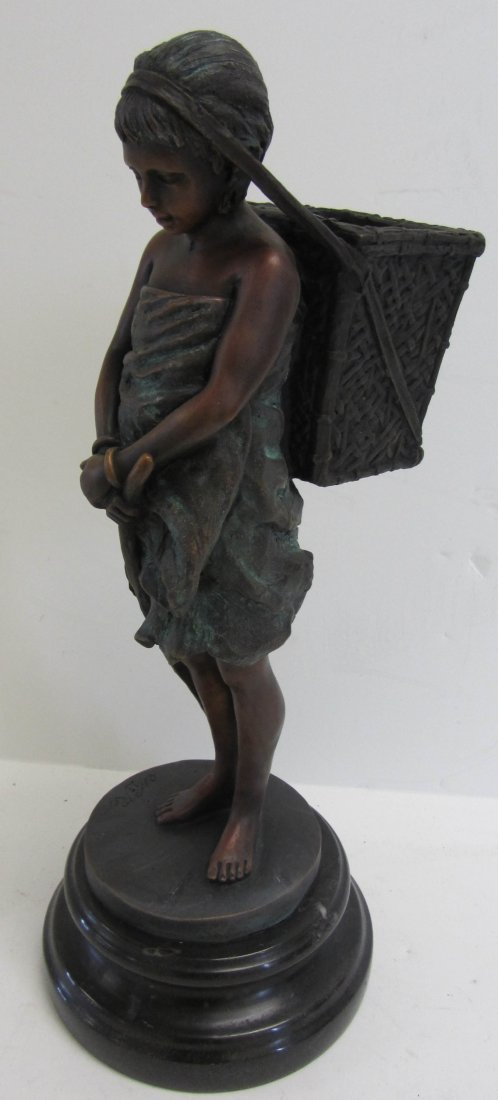 23: Bronze statue of child with basket on marble base