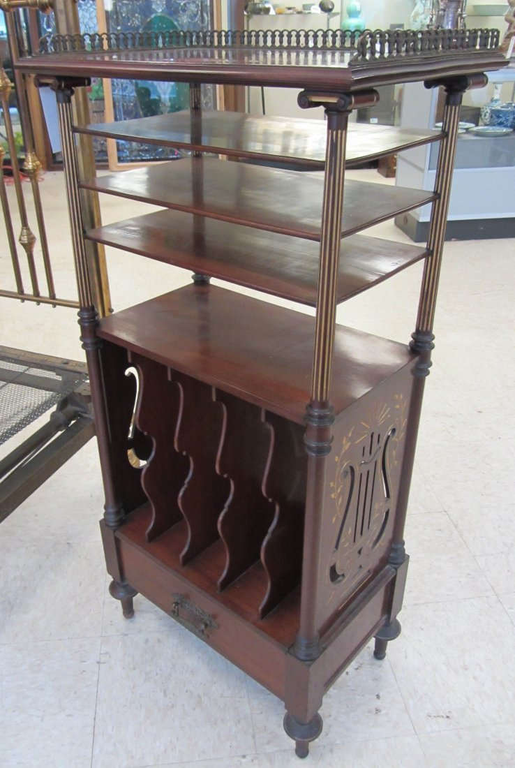 100: Victorian walnut incised 3 tier music cabinet